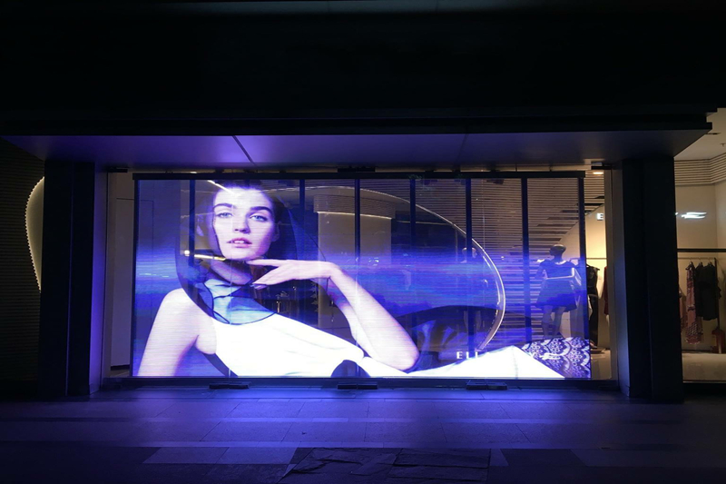P7.5 Semi-Outdoor Transparent LED Screen for Clothes Shop Glass Window Advertising